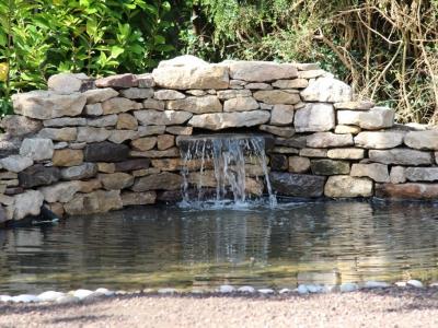 Pond, derrick construction builder, portishead builder, local builder, landscaping, natural stone, pebbles, pond pump, pond moulds, waterfall, handbuilt pond